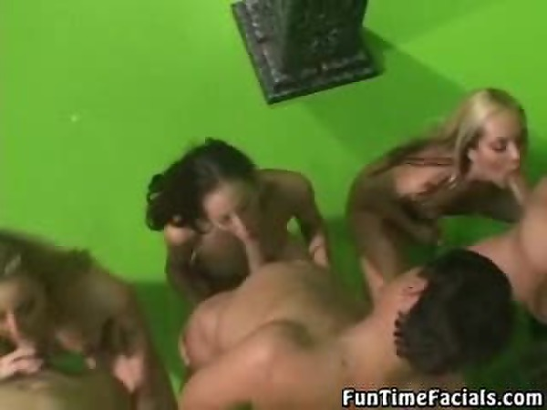 Four girls in a row sucking on four dicks