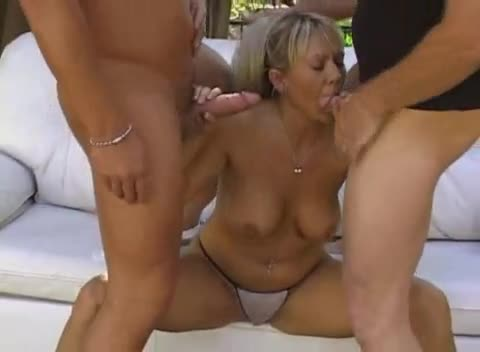 Milf on a couch outdoors gets fucked in DP