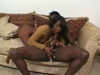 Glamorous black girl sucks on a BBC