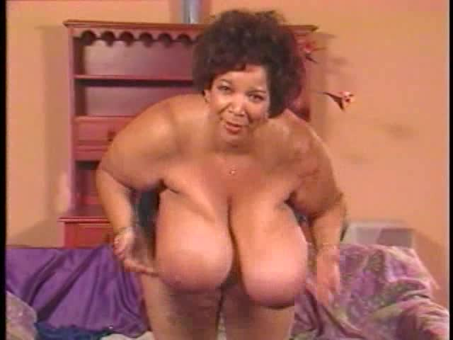 Mature black girl leans over and jiggles tits