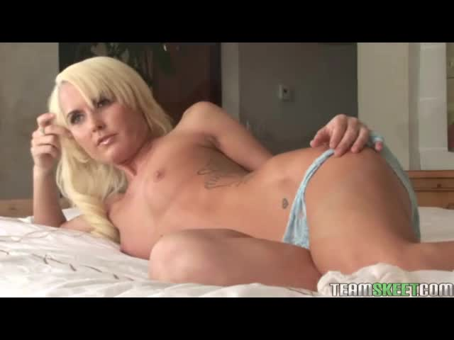 Slim beauty in blue lace panties solo tease