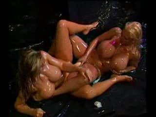 Huge boobs oiled up girls share a big dildo