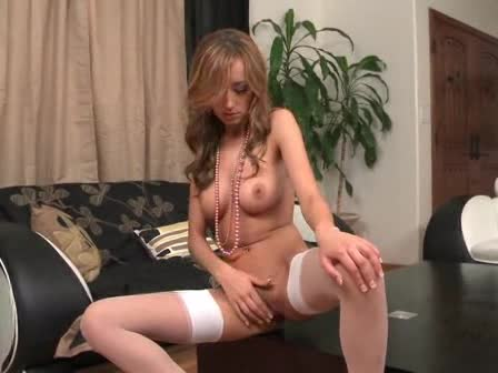 Young hottie in white stockings toys her vagina