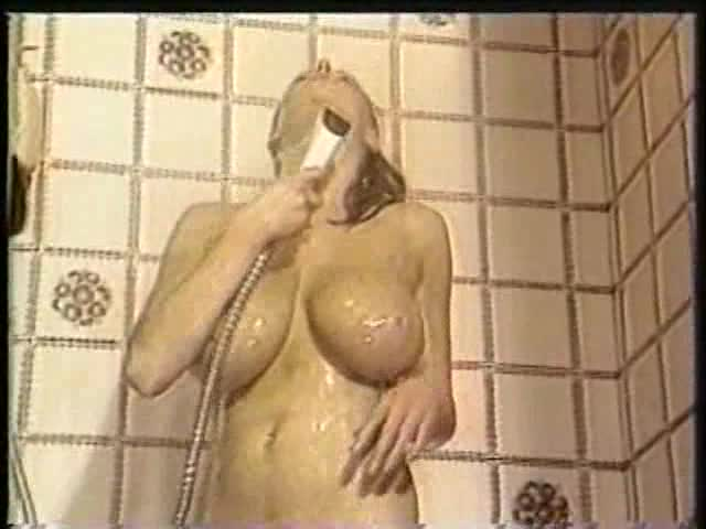 She washes her big natural tits in the shower
