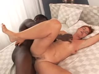 Mature redhead goes interracial for orgasm