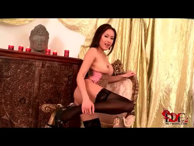 Asian chick is sexy in a corset