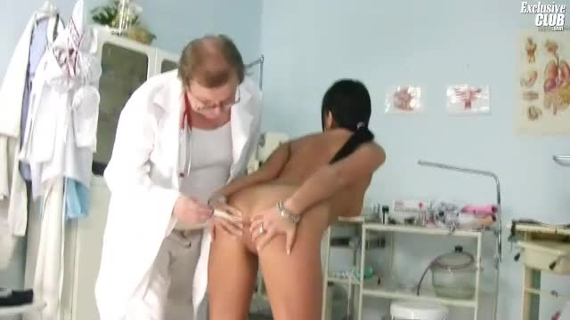He takes her anal temp and looks inside her pussy