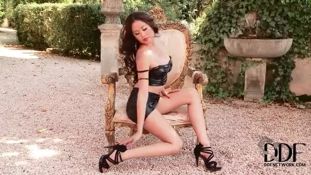 Asian in sexy latex outfit exposes her shaved pussy