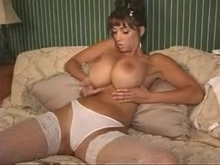 Slender babe with huge jugs plays with her pussy