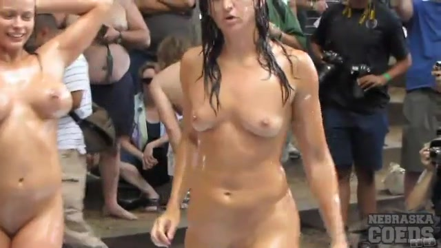 Ladies oil wrestling at naked party