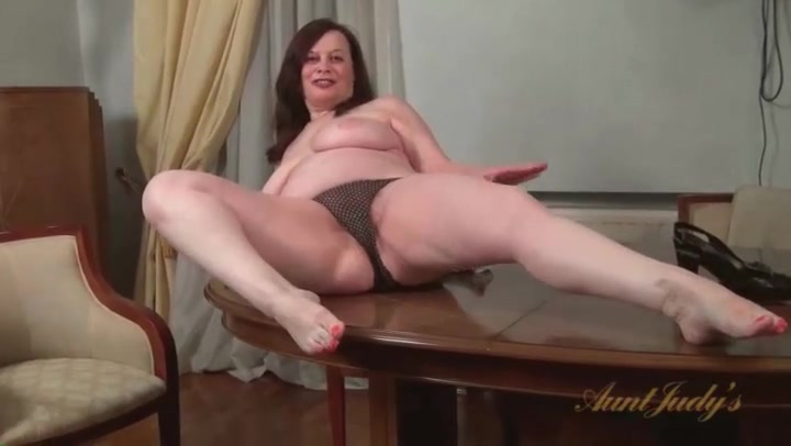 Fat milf exposes her hairy cunt for us