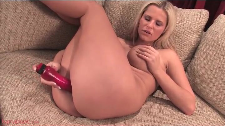 Blonde fucks her long pink dildo so deep