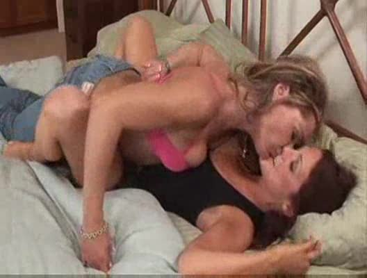 Lesbian makes love to young girl in her bed
