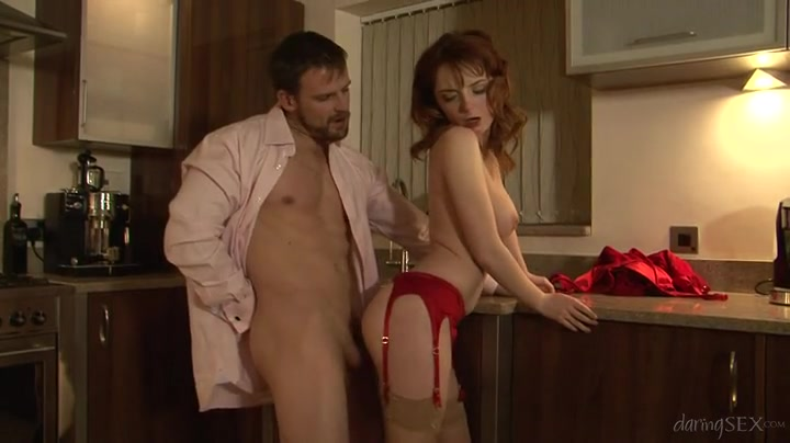 Redhead in a red garter belt fucked from behind