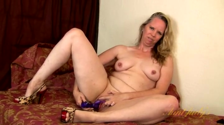 Sexy leopard print heels on a hot masturbating old lady