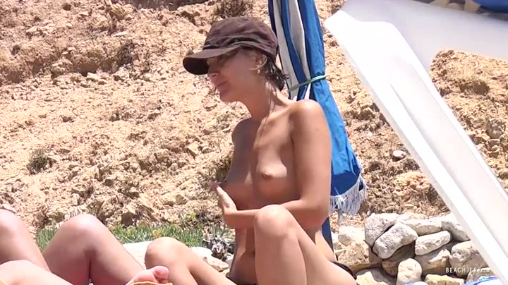 Topless girls hang out on vacation as we spy