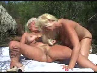 Two mature women make love in the grass