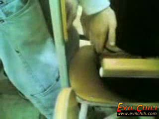 Young men fondling in the classroom