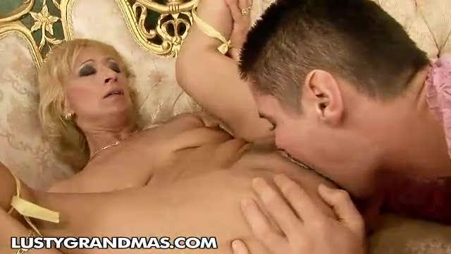 Guy in lingerie fucks a mature blonde
