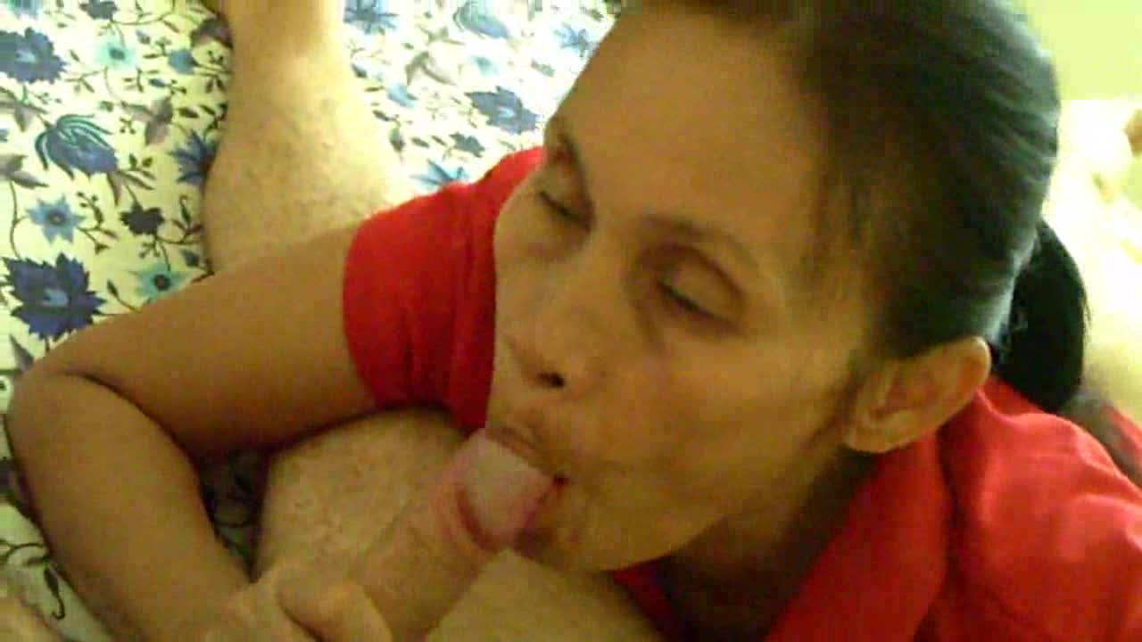 A mature Asian gives a blowjob