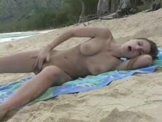 Pretty girl masturbating on pretty beach